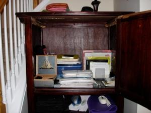 Unorganized TV Cabinet