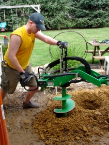 "Using the ""One Man Auger"" to drill for the Footers"