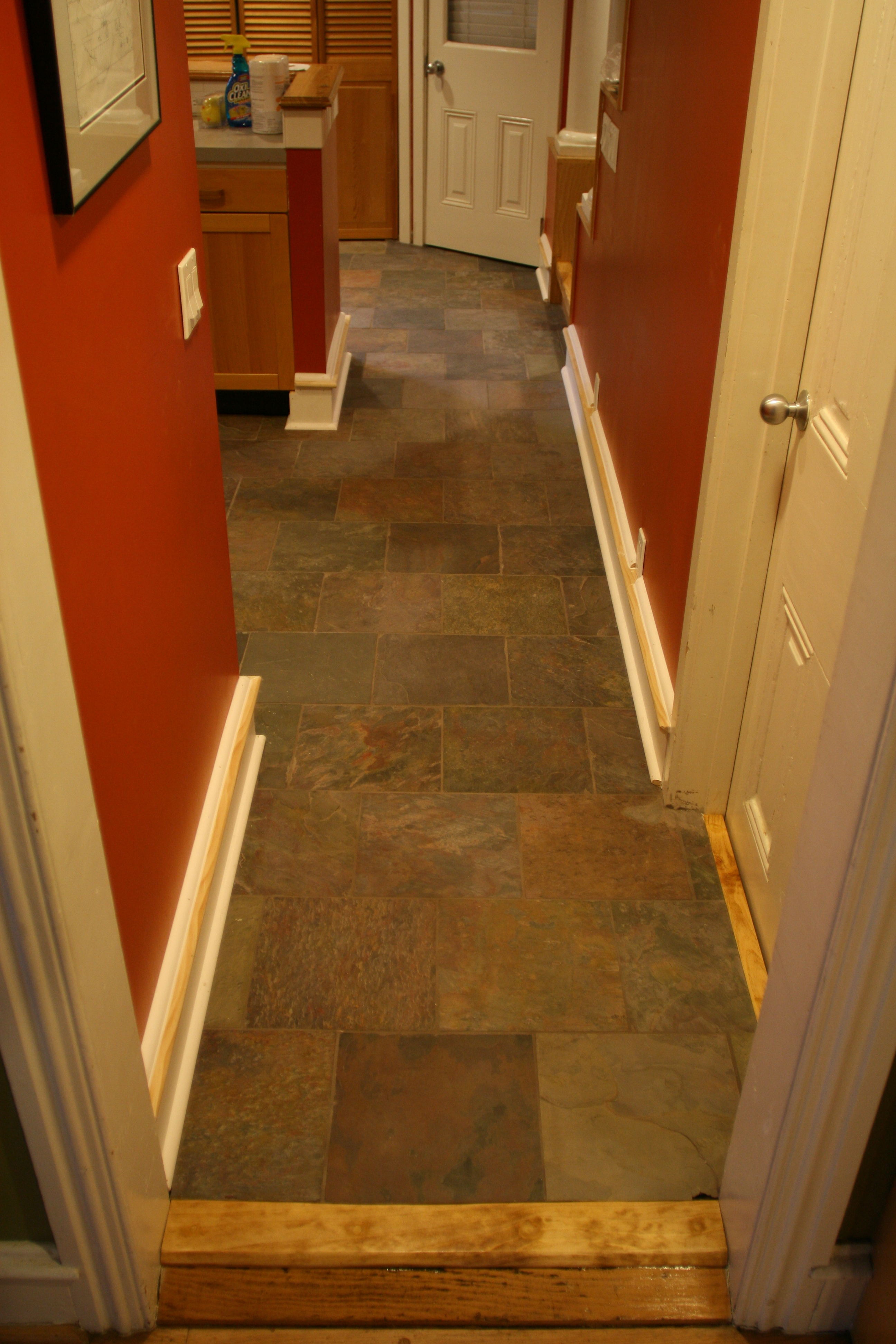 Slate floor new baseboard manayunk phila pa aaron whomsley new slate tile floor leading from the dining room into the kitchen a custom riser was made to hide the rough edge of tile at the threshold of the dining dailygadgetfo Images