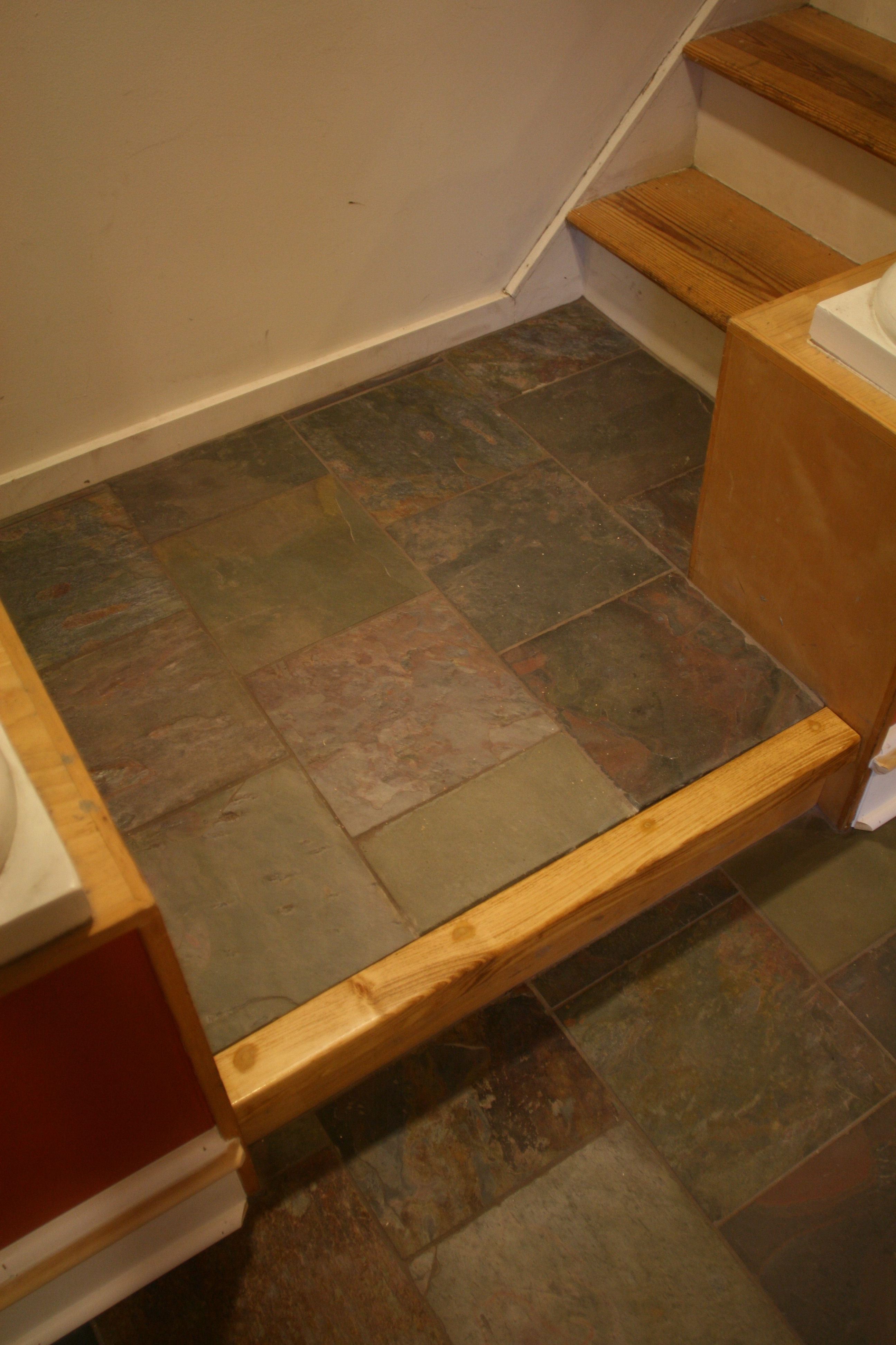 Slate floor new baseboard manayunk phila pa aaron whomsley llc the clients and i also decided to tile the step at the base of the rear staircase a custom riser was made to cover the rough edge of the tile and cap dailygadgetfo Image collections