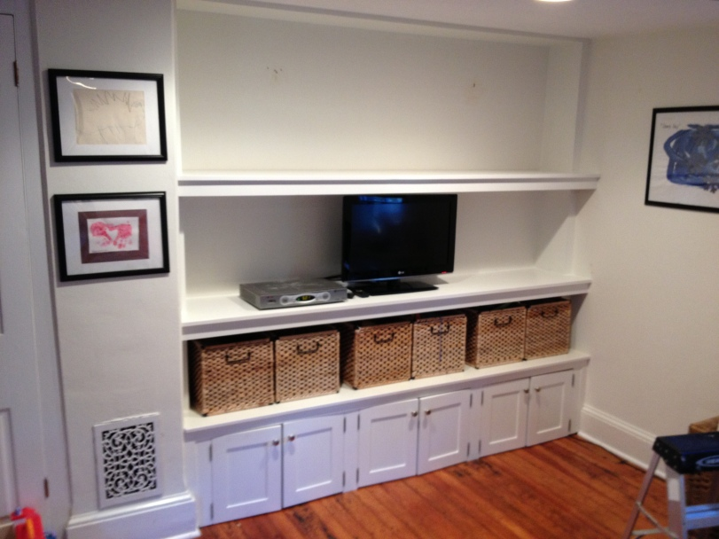 Here the custom made doors (by AWLLC) were installed to the vertical 1x material to close in the lower area.  The TV and cable box were installed with wire management to hide the wires.