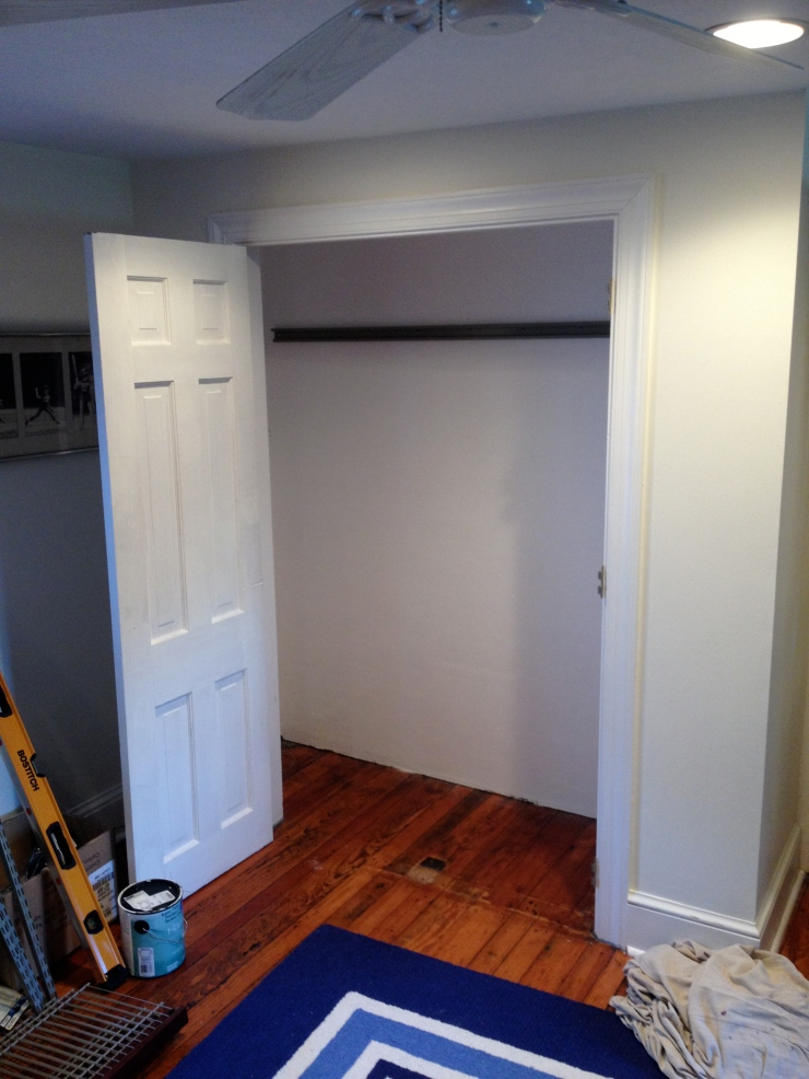 Once the wall paper was removed I spackled the problem areas, sanded the walls, primed and painted the closet.  After the closet was dry the shelf hanging bar was installed.
