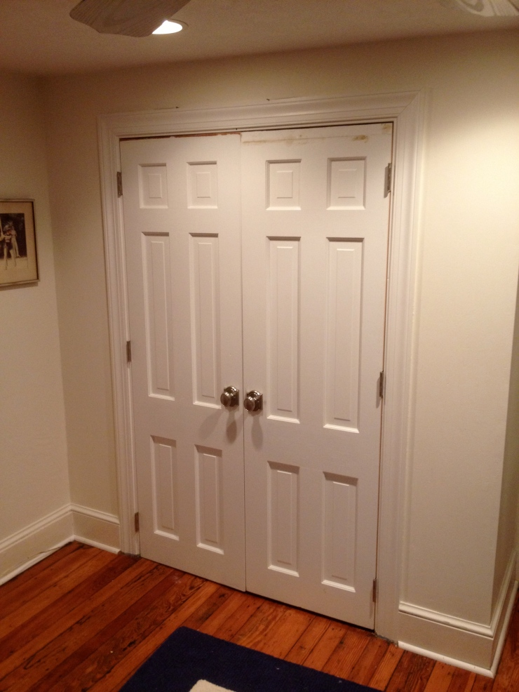 Here the doors are fully installed with new hinges and Baldwin Brass knobs.