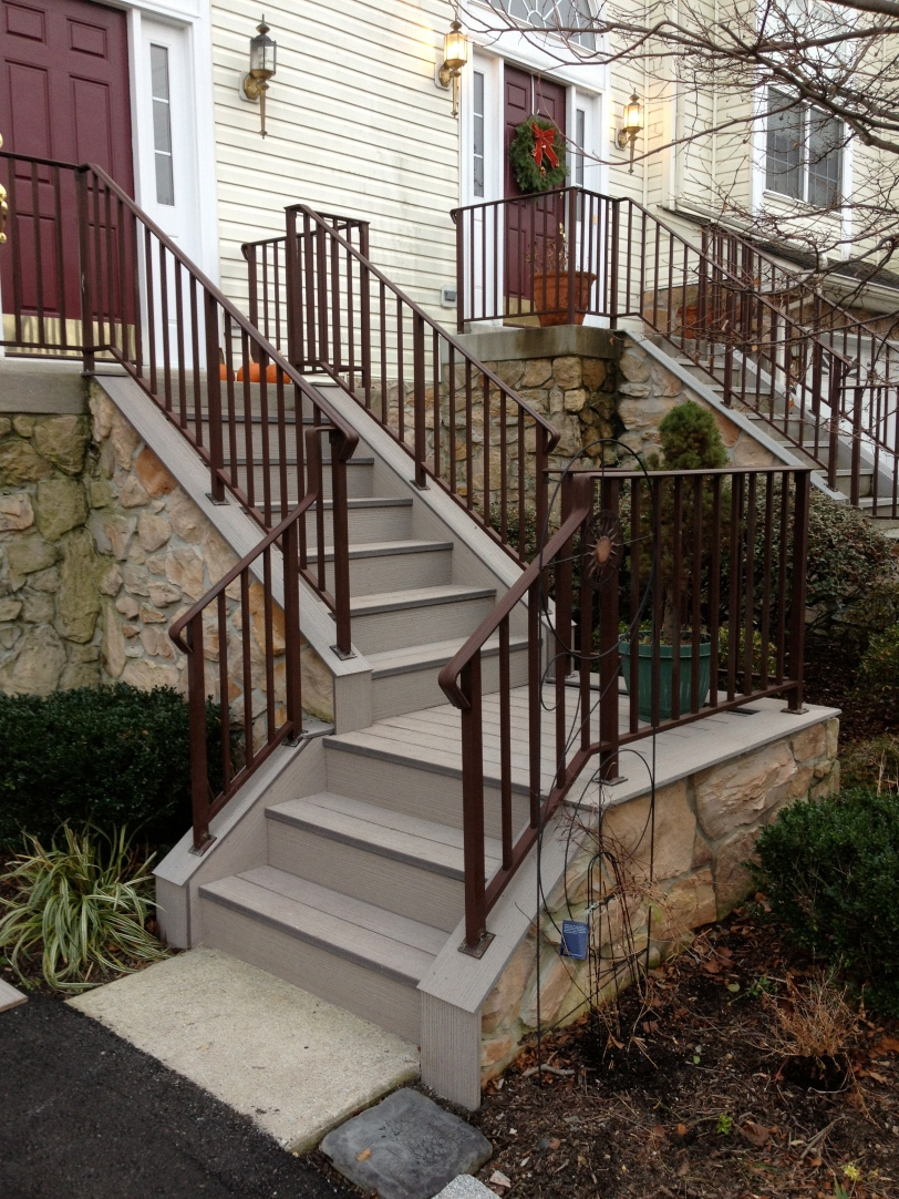 Railing reinstalled and the new steps are finished.