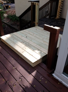Cut the original rail out of the way and installed the pressure treated decking.