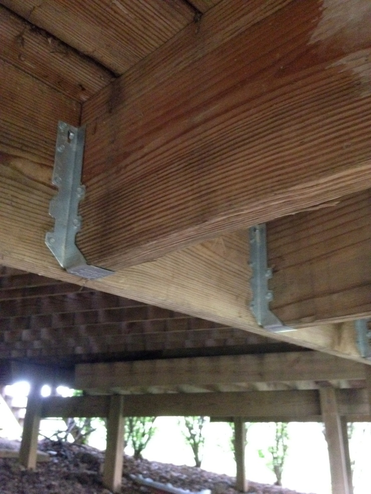 "And here are the new joist hangers installed. I always upsize the hangers as compared to the size of the lumber. These 2x12 hangers in addition to the roughly (40) 1/2"" carriage bolts I put into the beams and posts. This was all completed before the new railing was installed."