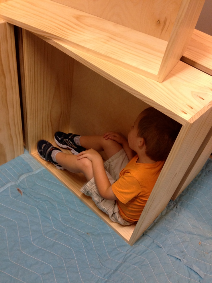"""When I build projects either one or both of my sons are usually with me, helping or playing, as I work. As I was loading the boxes into my trailer my oldest, Conor, decided to see just how big the 27""""x27"""" drawer boxes were. He fit right in with room to spare."""